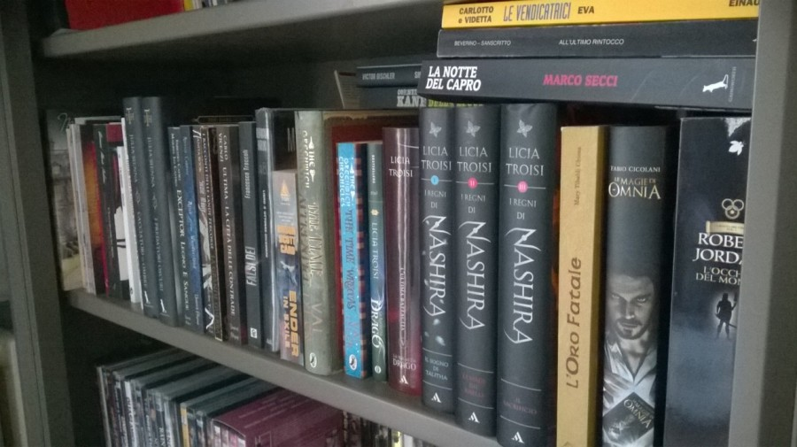 My to-read shelf. Nota bene: there is another row of books behind.